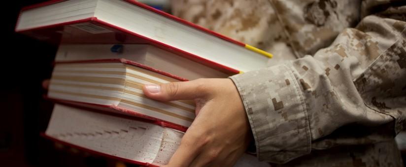 servicemember holding books